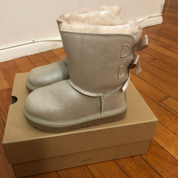 49100e31290 Ugg Bailey bow boots shimmer gold toddler NWT